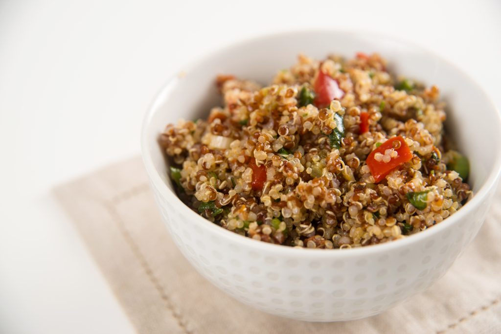 a close-up of a bowl of whole-grain quinoa tabouli salad