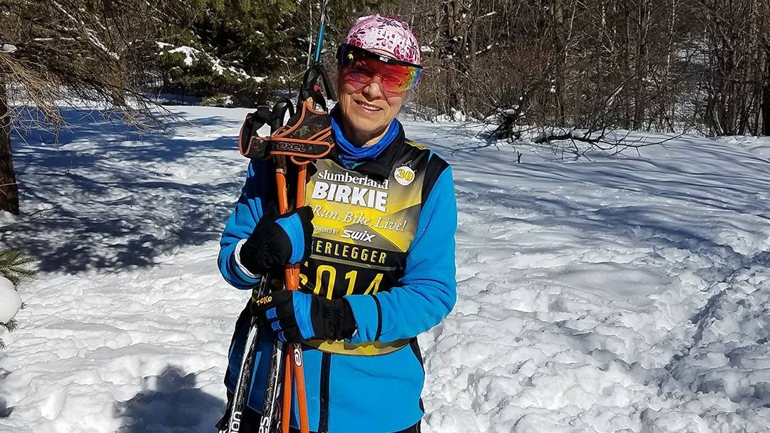 Sharing Mayo Clinic knee patient Marva Sahs outside in the snow with her skis