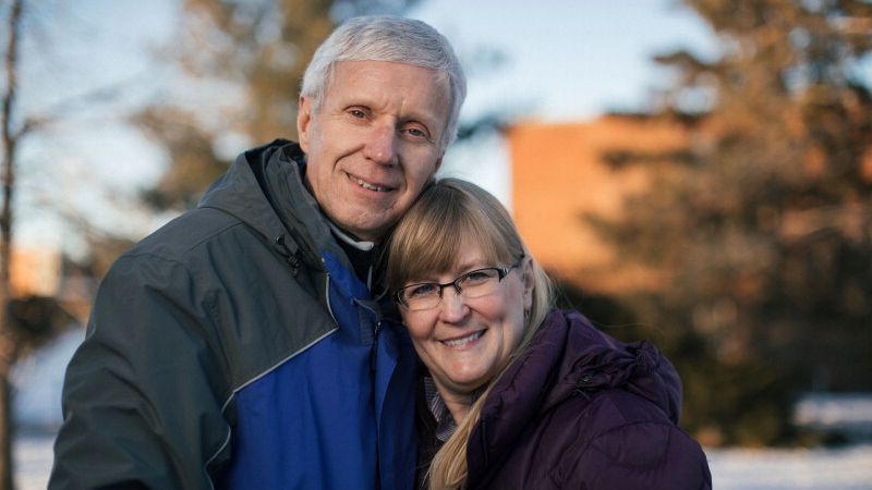 Beverly and Dr. Deyo-Svendsen in Menomonie, Wisconsin outside, bundled up in winter coats and smiling