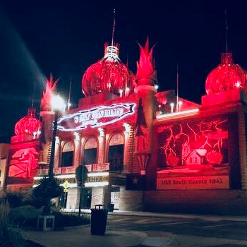 the Corn Palace in Mitchell, South Dakota, glowing red in honor of In the Loop patient Kadie Neuharth