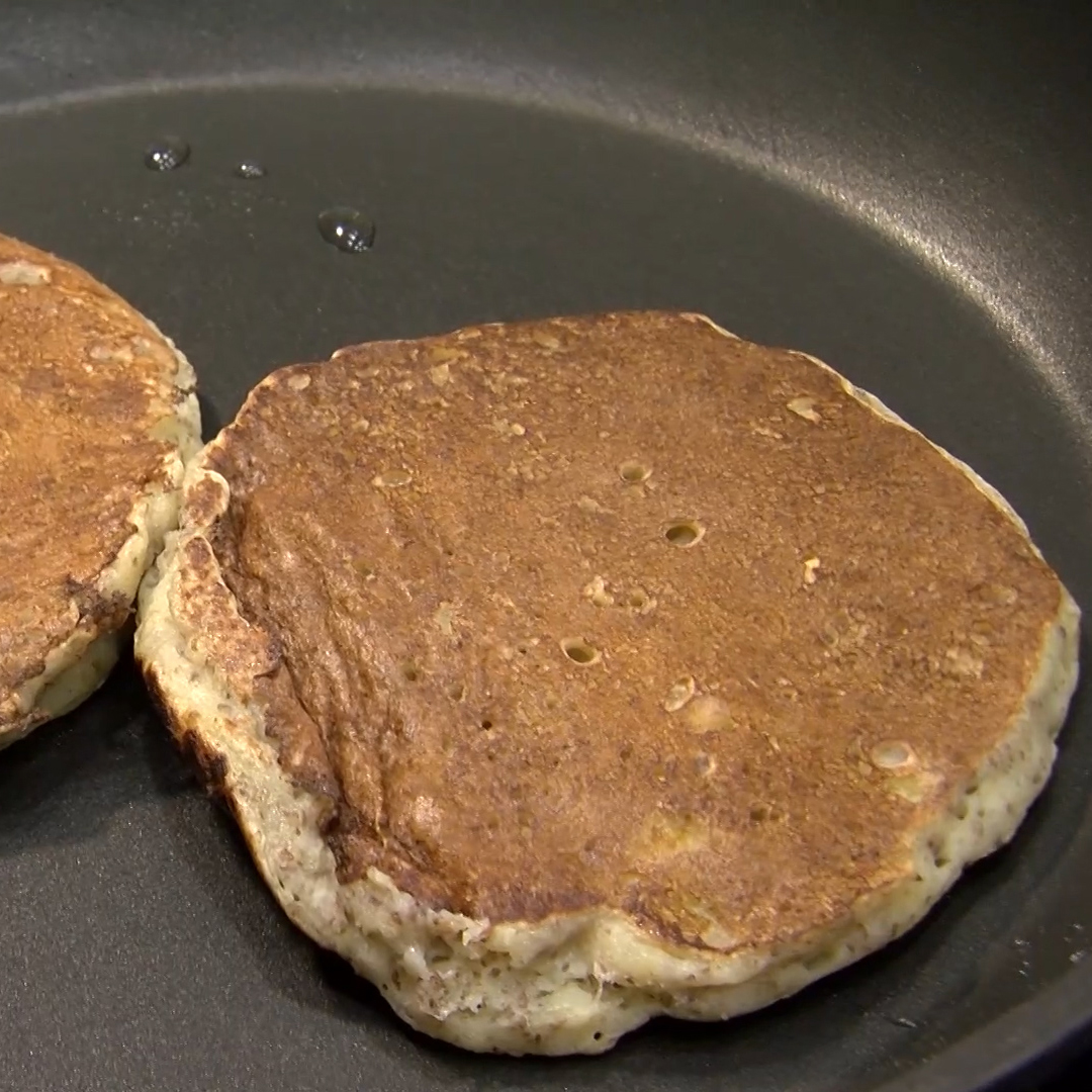 Two flaxseed pancakes on a plate.