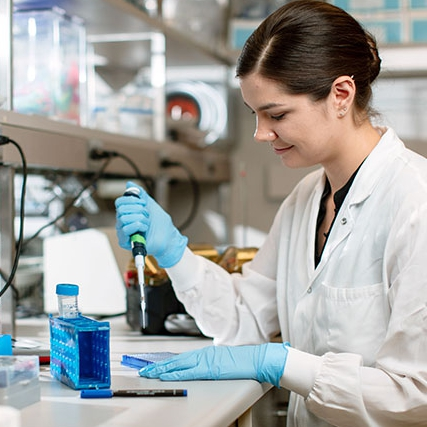 Biomedical researcher in laboratory