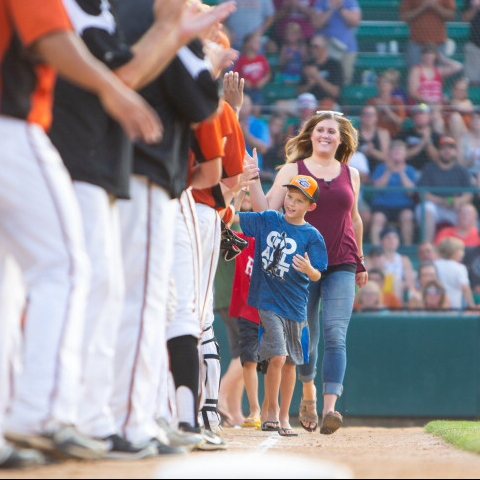 cervical cancer patient Megan Brooks walking on the baseball field