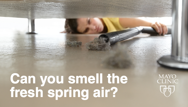 spring cleaning graphic with woman vacuuming dirt and dust balls under furniture