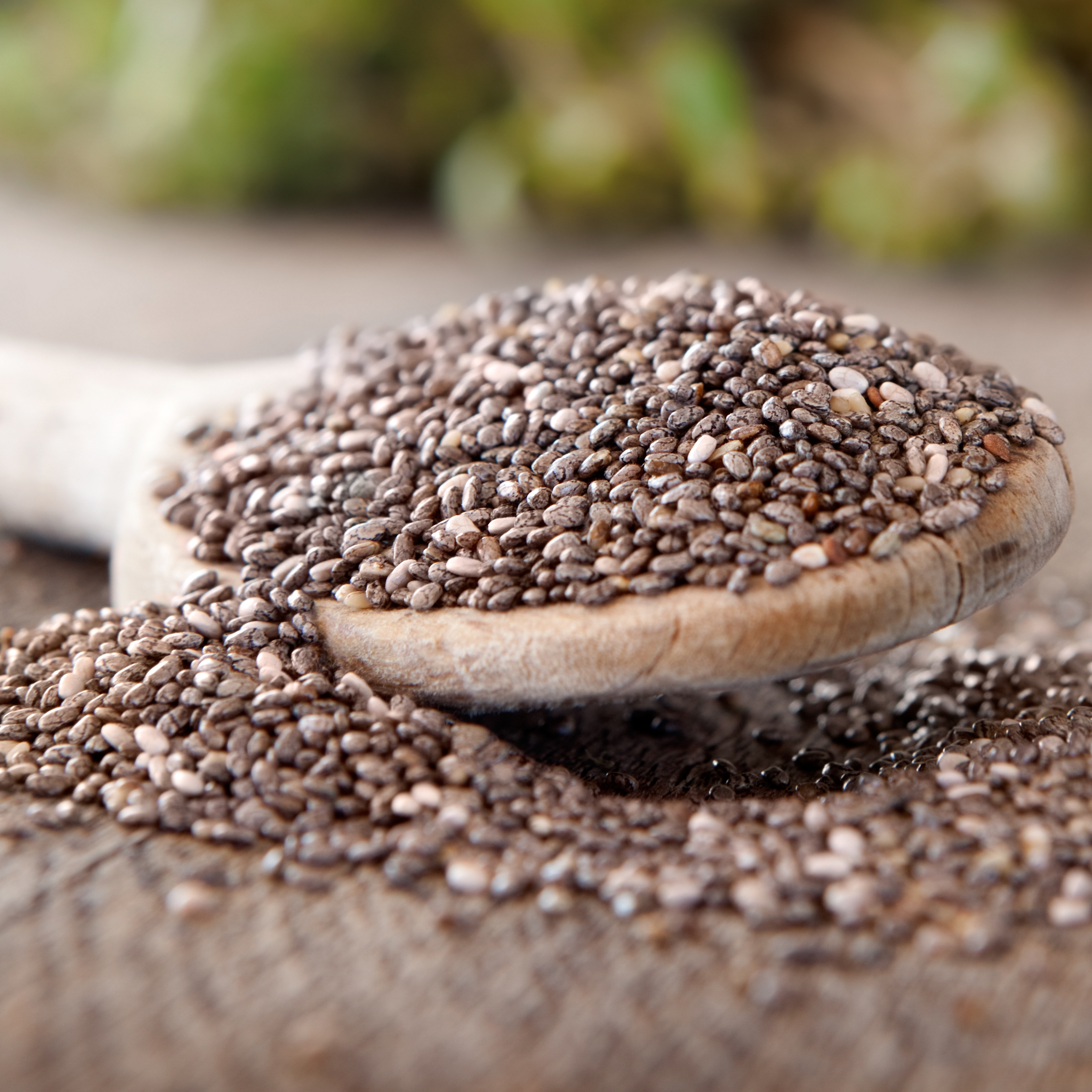 a wooden spoon filled with chia seeds