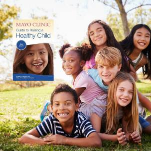 the Mayo Clinic Healthy Child Book graphic embedded in an image of a group of children laughing, smiling and playing outside in a park