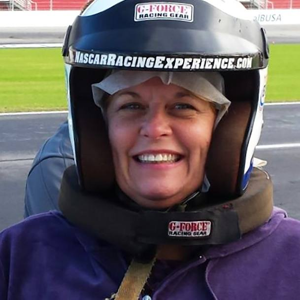 pancreas transplant patient Mary Shelley with a racing helmet on at the car track