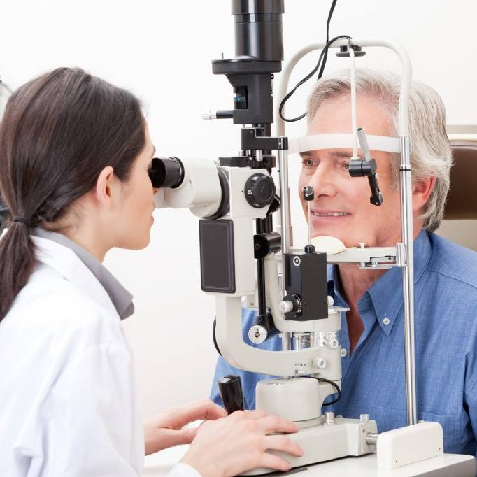 Adult man having vision checked with eye exam
