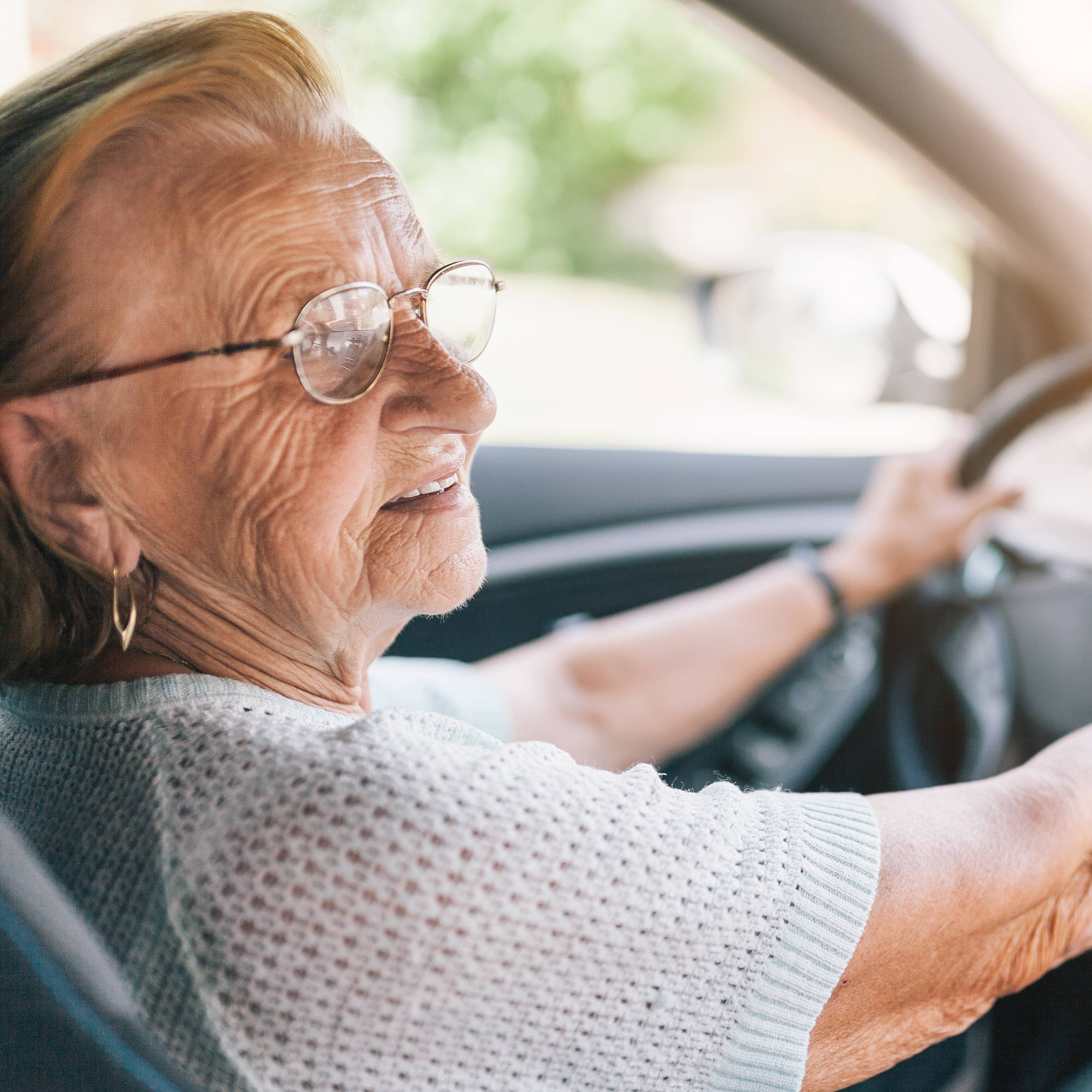 Elderly woman driving car