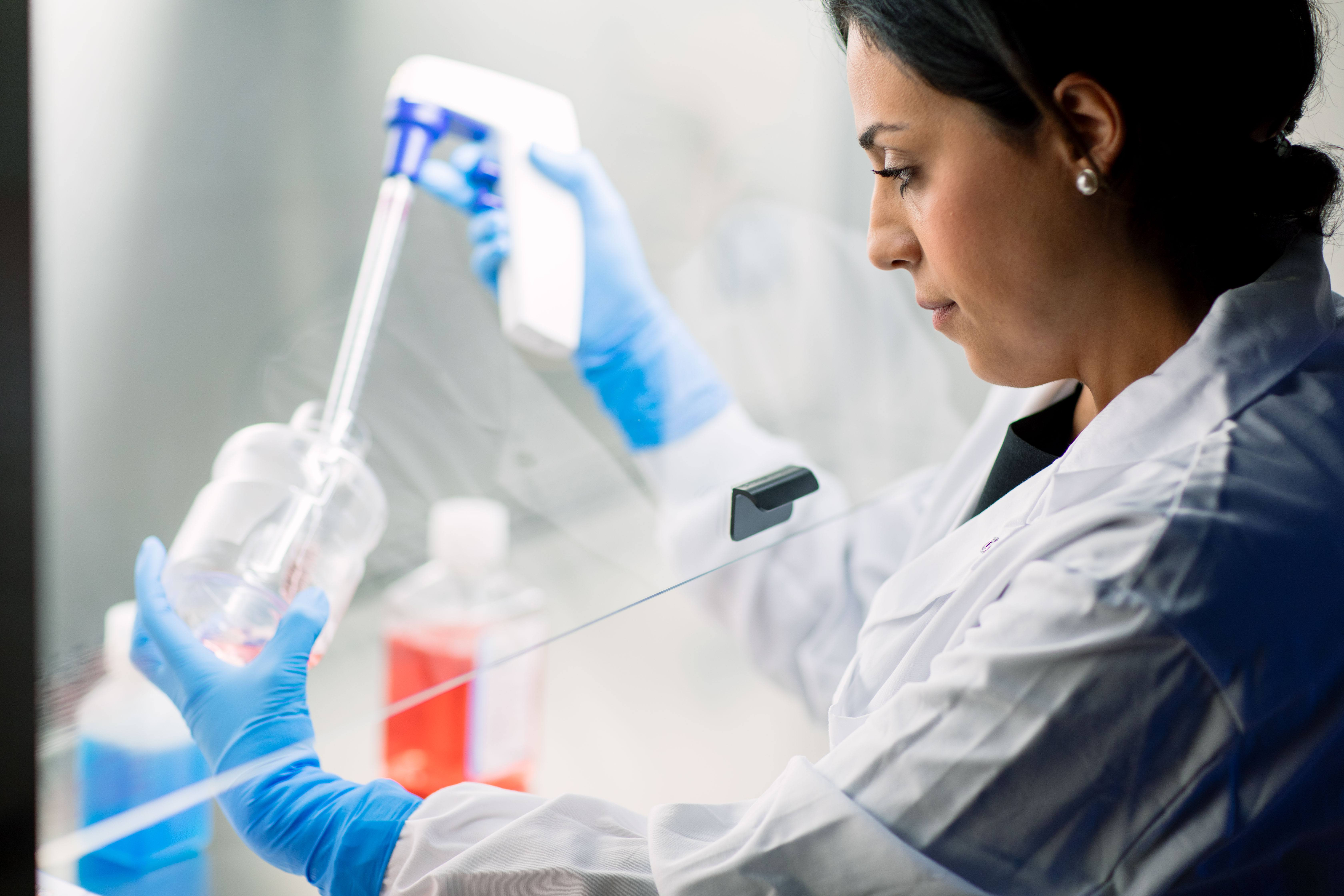 regenerative medicine researcher pipetting stem cells