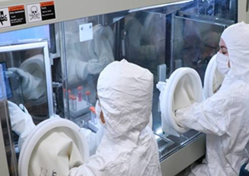 Researchers in a cGMP clean room.