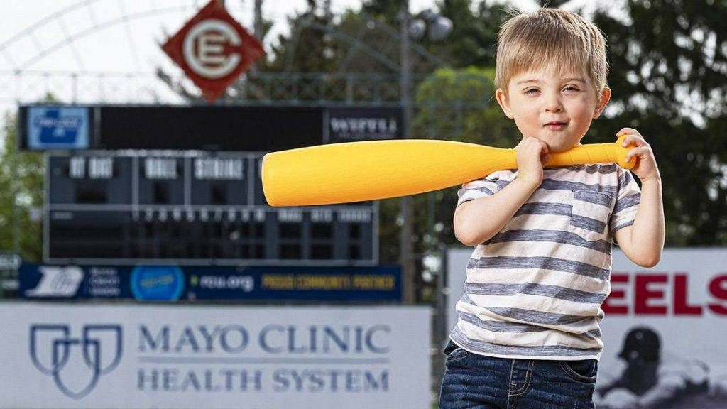 Sharing Mayo Clinic patient Matthew Makela smiling and holding a plastic baseball bat