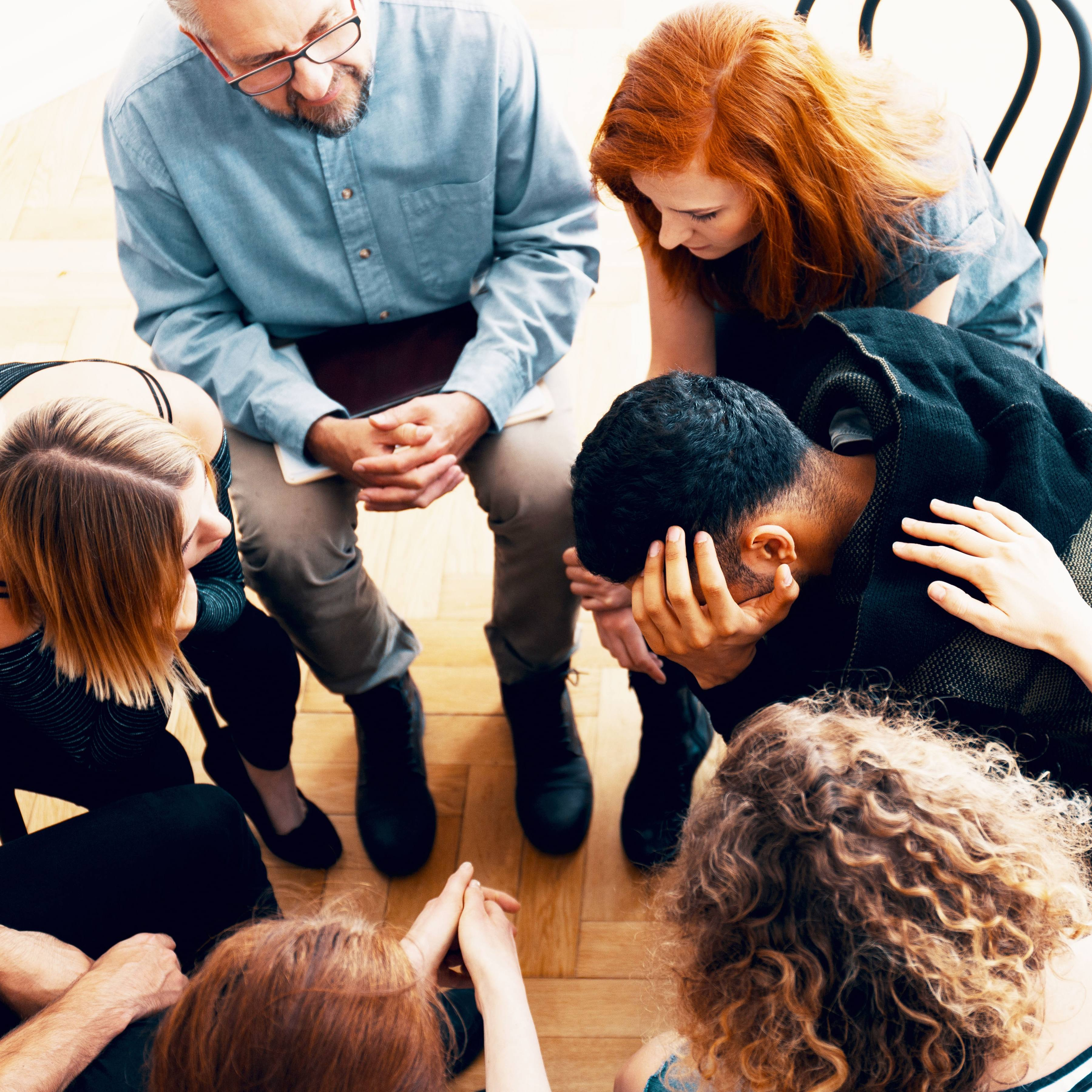 a group of young adults or teenagers in a circle, who are in counseling therapy, supporting and helping each other with depression, sadness, maybe suicidal thoughts