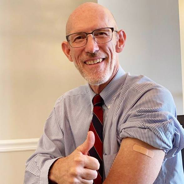 Dr. Gregory Poland gives the thumbs up for a flu shot selfie.