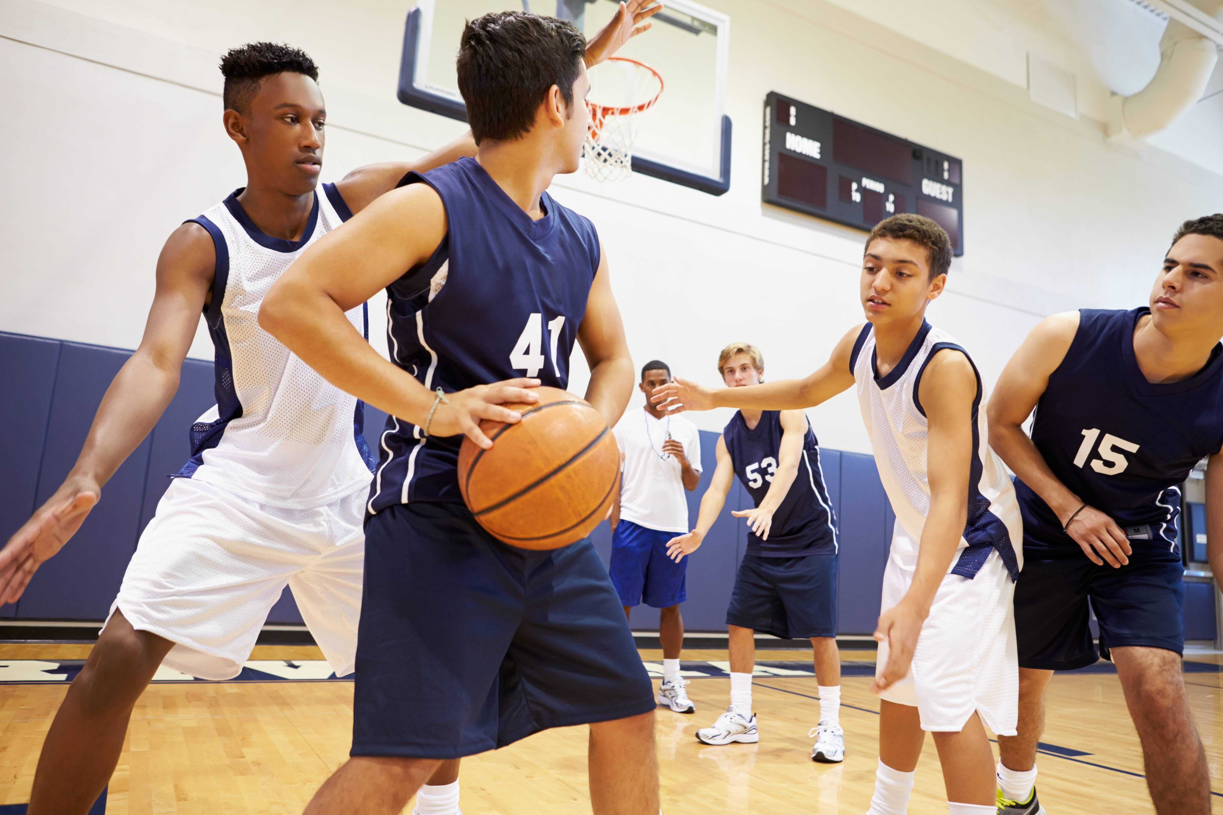 male high school basketball players playing game