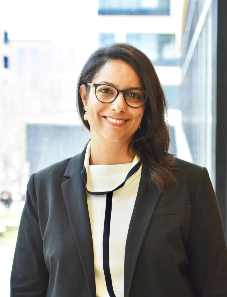 Rita Khan Mayo Clinic Chief Digital Officer, Center for Digital Health, in a gray business jacket, wearing glasses and smiling outside a building