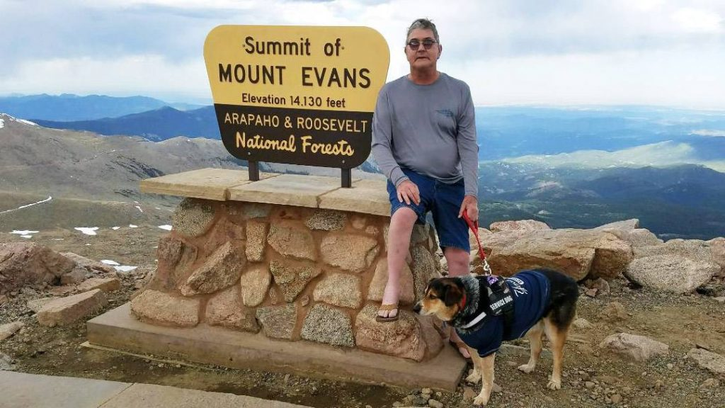Sharing Mayo Clinic patient Tim Thomforde hiking with his dog