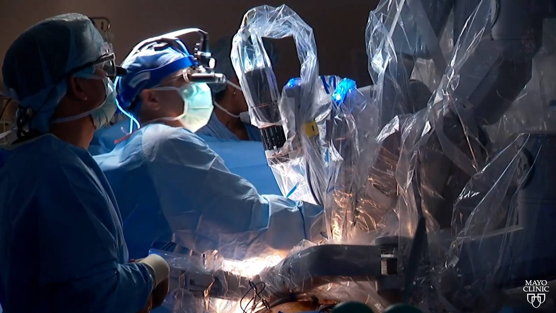 Mayo Clinic surgeons in the operating room performing robotic mitral valve surgery