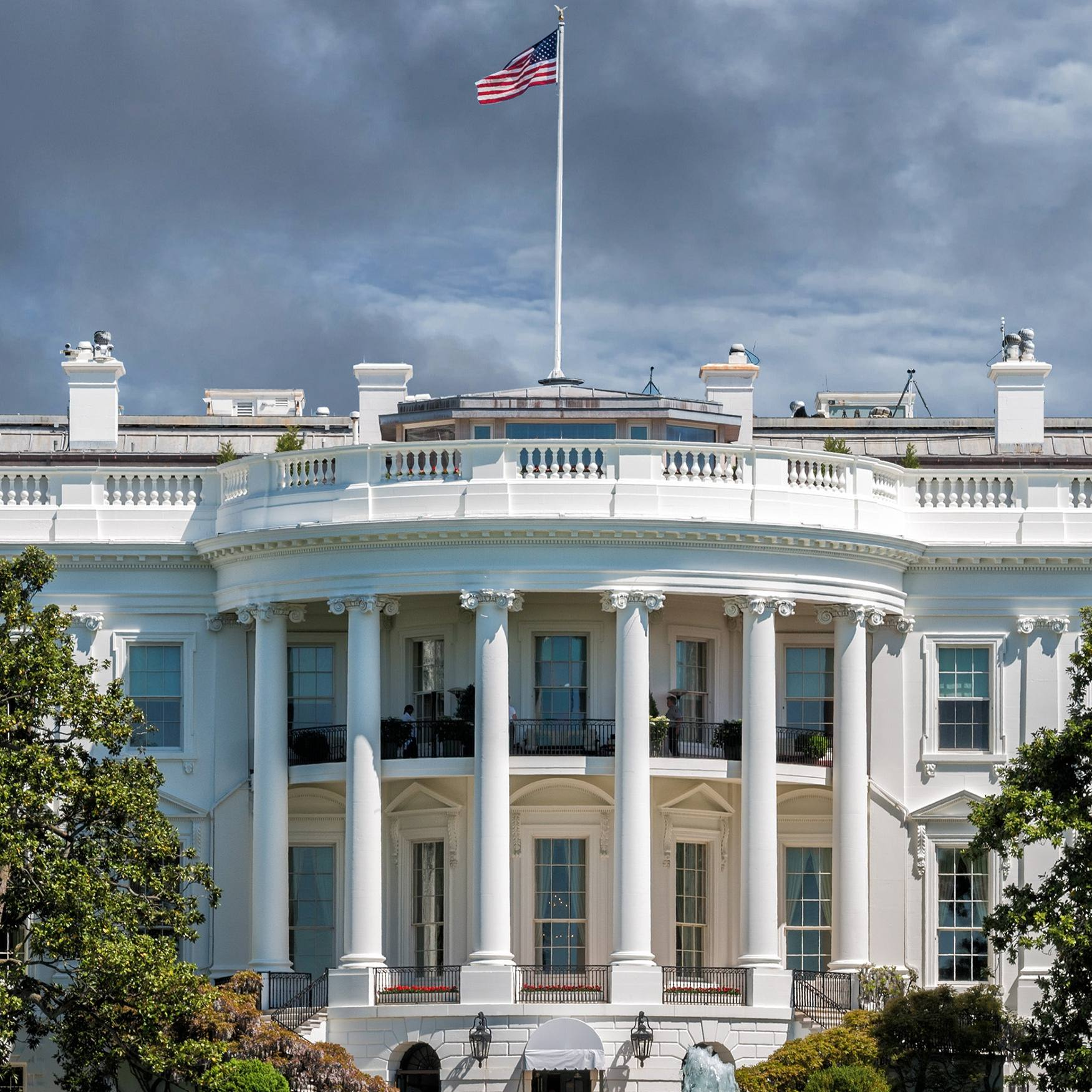 the White House in Washington DC on a gray stormy day