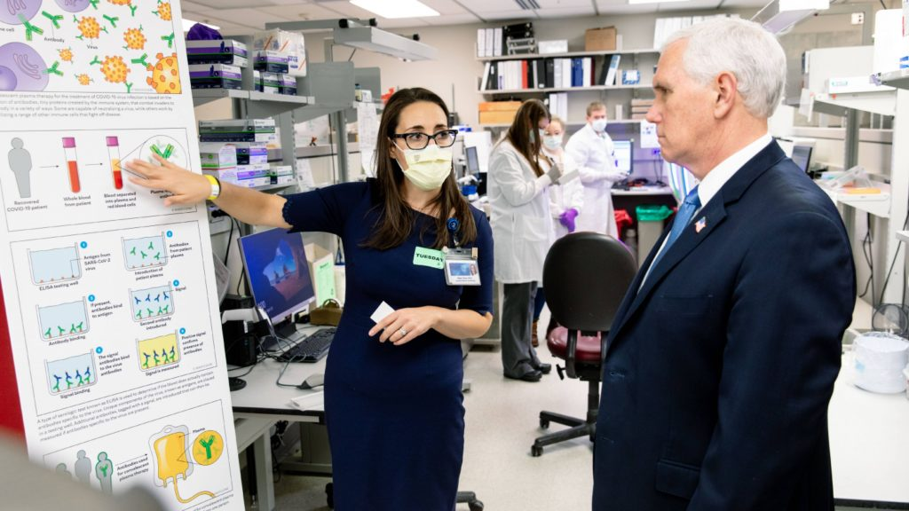 Vice President Pence in a Mayo Clinic lab with a researcher explaining convalescent plasma for COVID-19 testing