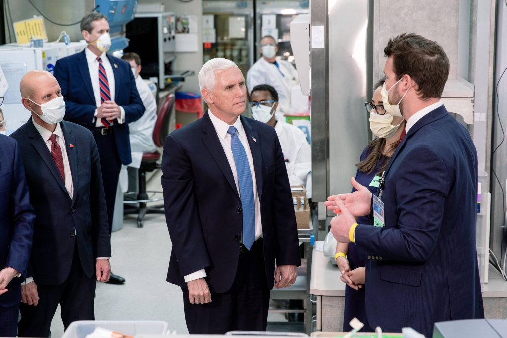 Vice President Pence listening to a researcher describe the lab work with COVID-19 testing