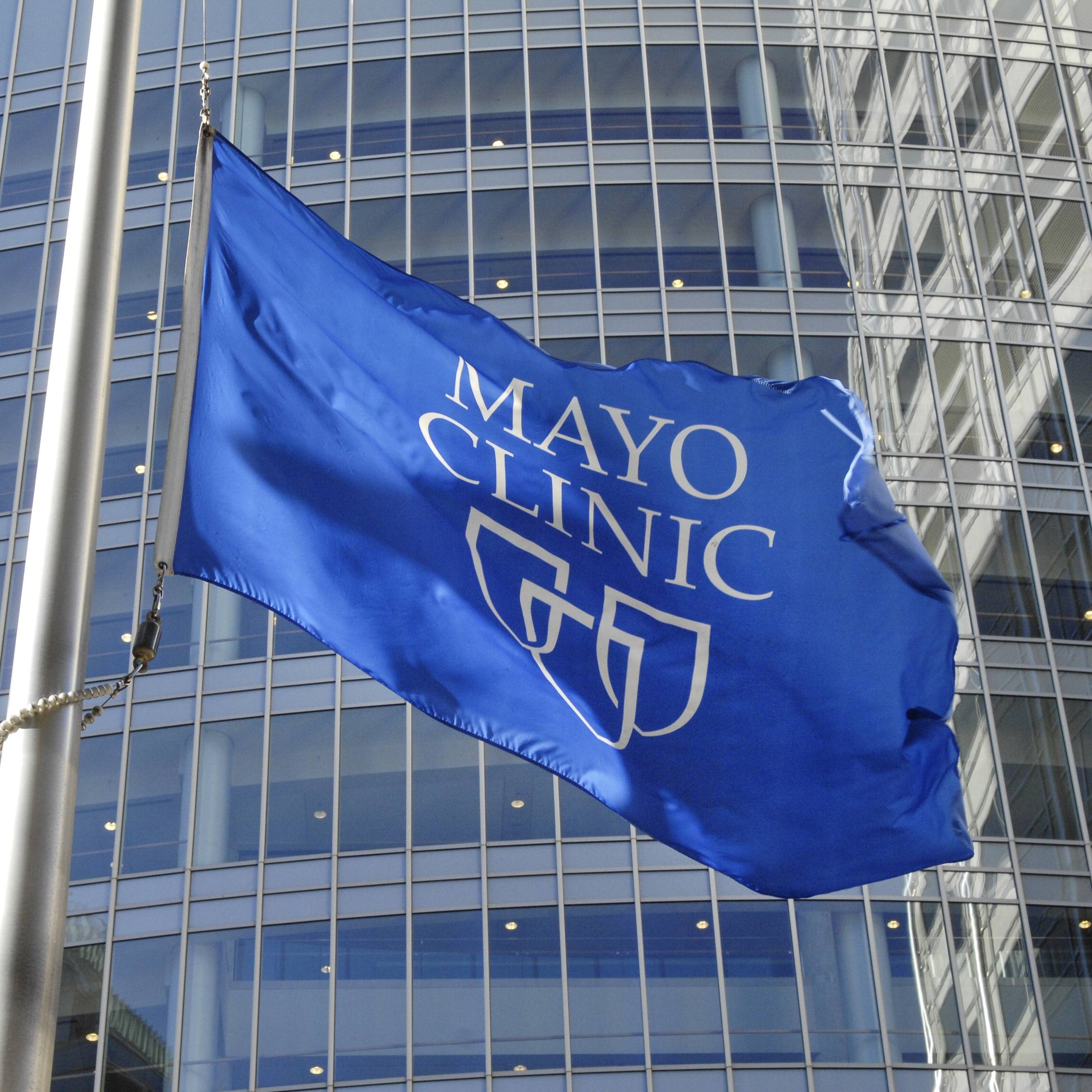 the Mayo Clinic blue and white flag with three shield image, flying outside the Gonda Building