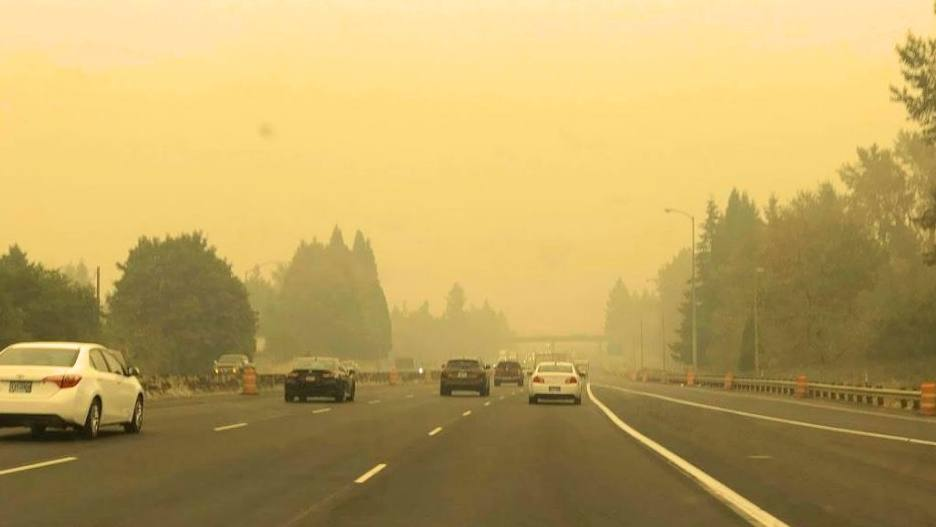Wildfire smoke on across a highway in Oregon