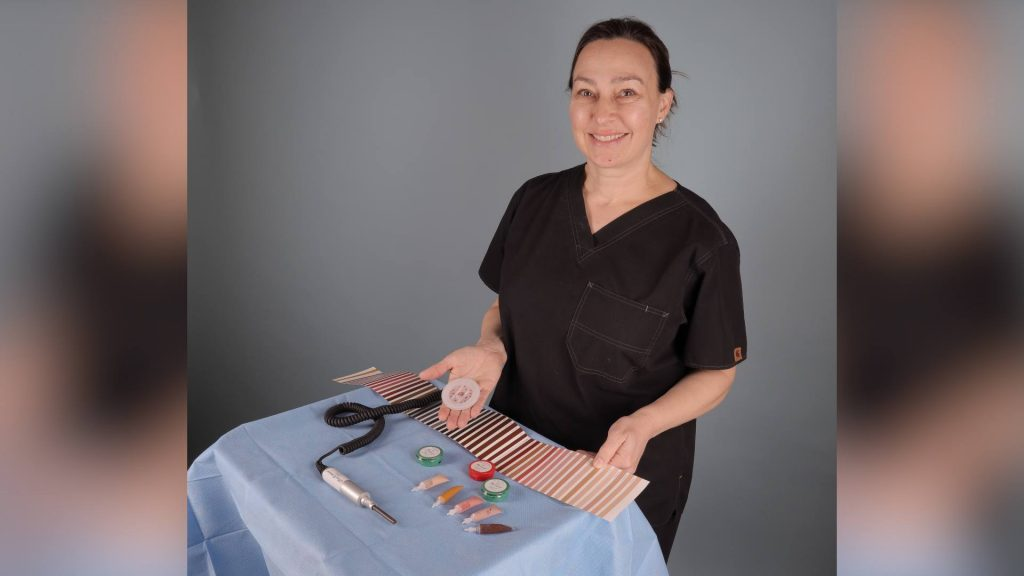 Dr. with her surgical tray, her tattoo needle machine and different colored paints