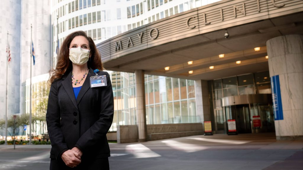 Amy W. Williams, M.D. Executive Dean for Practice Mayo Clinic standing outside the Gonda Building wearing a face mask
