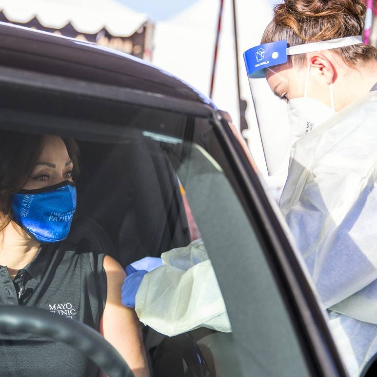 Mayo Clinic Dr. Alyssa Chapital wearing a face mask, in her car getting the COVID-19 vaccine at Honor Health
