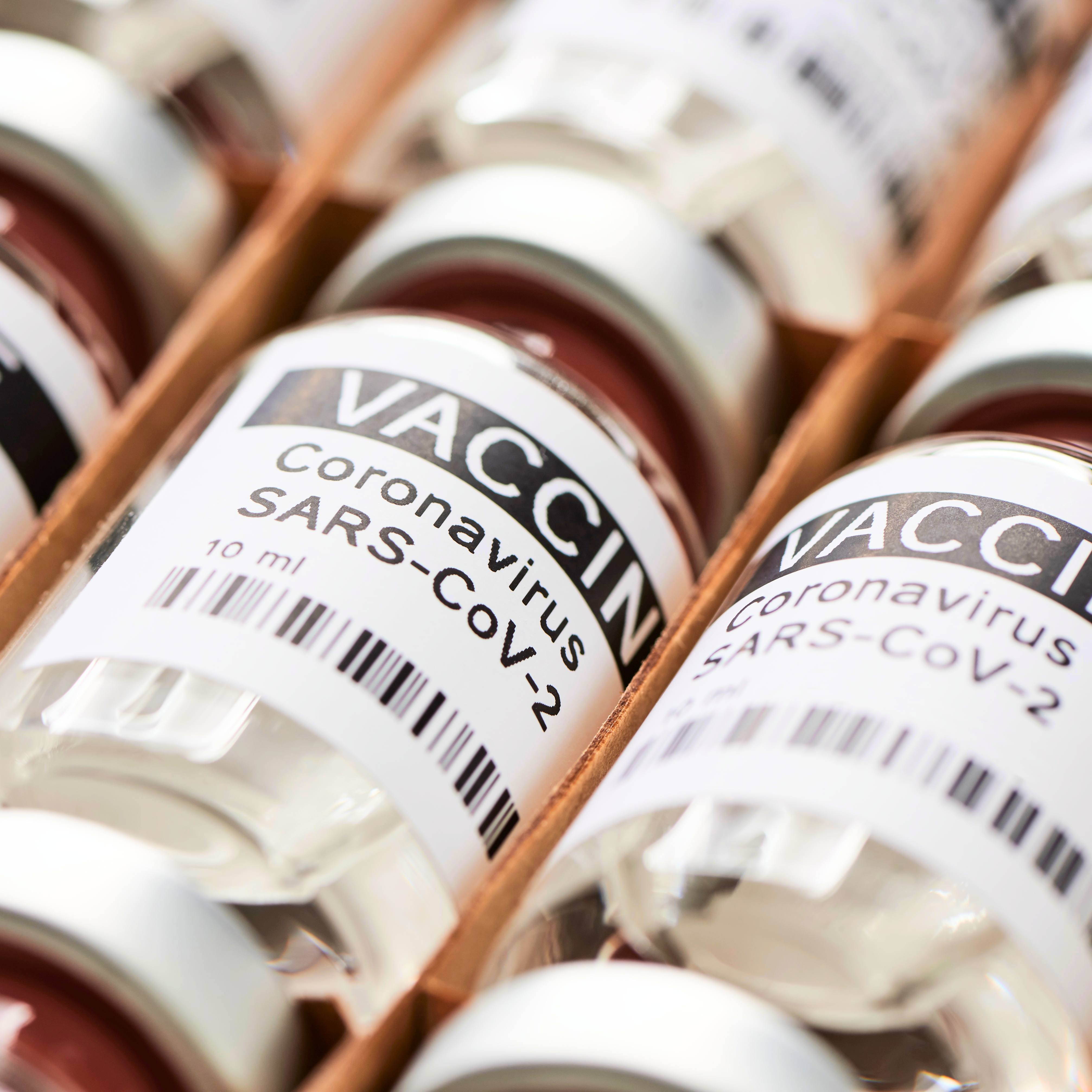several laboratory vials labeled COVID-19 Coronavirus SARS-CoV-2 Vaccine in a delivery box
