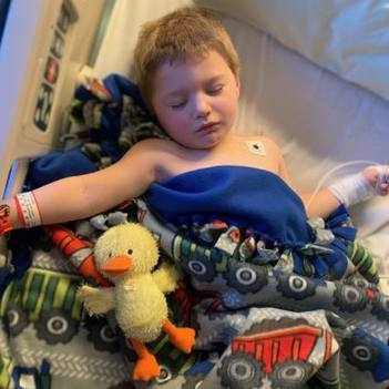 head injury patient Andrew Holmquist asleep with a blanket