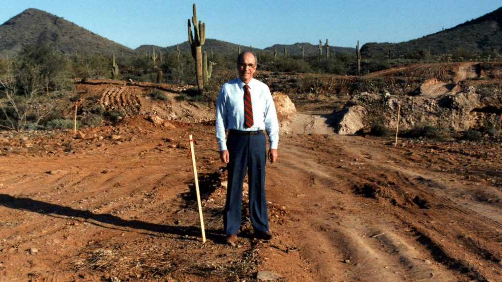 Richard Hill, M.D., standing with a shovel on the site of the future Mayo Clinic campus