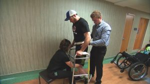 Spinal Cord Stimulation, Physical Therapy Help Paralyzed Man Stand, Walk With Assistance