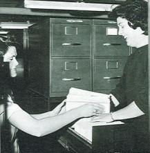 Mrs. Carol Harmon and Betty Grove file histories on Harwick's third floor.