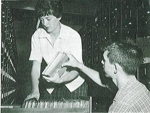 Temporary employee Donald Twentyman assists Joyce Kleeberger.