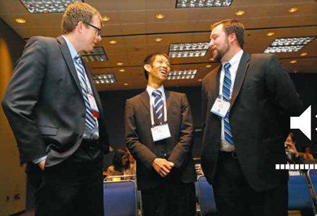 Image Credit: CLN Daily. Presenters John Mills (from left), Shuhei Mamiya, and Jeff Meeusen share a light moment before Monday's Student Oral Presentation Contest.