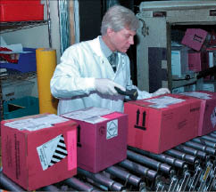 Specimens arrive at Mayo Medical Laboratories in berry-colored shipping boxes.