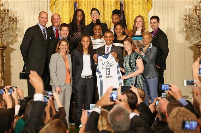 June: Minnesota Lynx team members present a Lynx jersey to President Barack Obama.