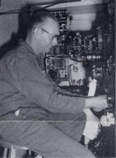 Charles Redwine works on installation of x-ray controls. Approximately 20,000 feet of wiring was used for x-ray installations alone.