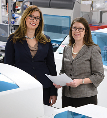 Dr. Nikola Baumann, Ph.D., (left) and Darci Block, Ph.D., co-directors of Mayo Clinic's central clinical laboratory. Photo courtesy of CAP Today.