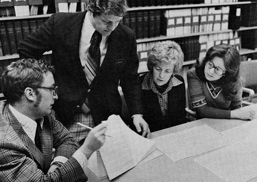 Epidemiologists Fred Annegers and Lee Melton III, left, examine some statistical data with nurse Mary Beard, supervisor of the Rochester Project, and Dr. Jan Scarlett, a veterinarian associated with the project.
