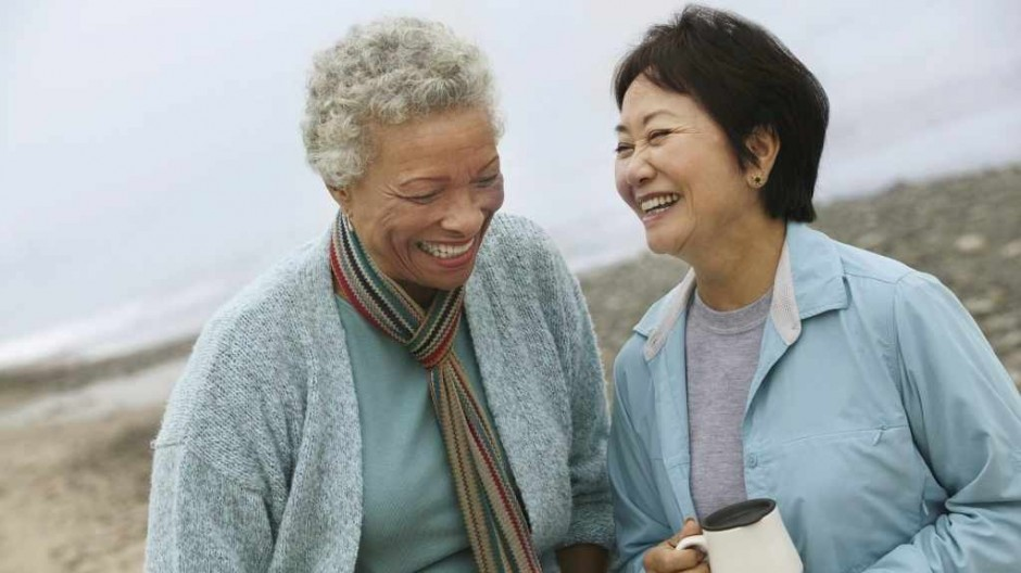 middle-aged-women-friends-laughing-and-comforting-each-other-on-a-walk-16x9-