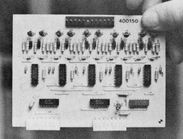Intricate circuit cards attached to the back of the organ were wired to instruct the old machine in sophisticated new tricks.