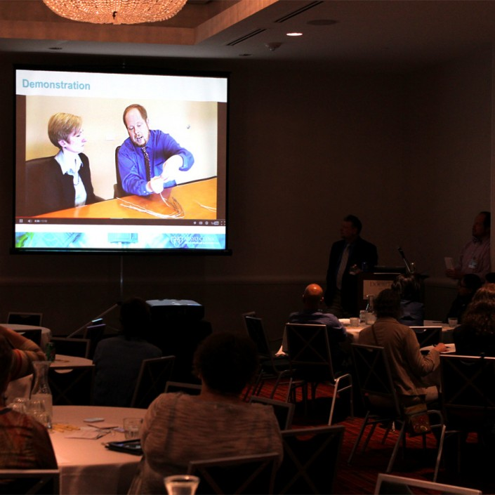 Mike Baisch plays a short video during the session to demonstrate job instruction best practices.
