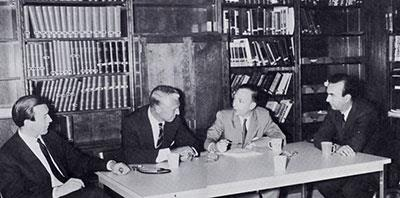 The library-conference room is focal point of the unit's education program. From left are Dr. Gerald Bevan, Dr. Summerskill, Dr. Phillips and Dr. G. Devroede. Daily conferences for staff and residents are held here.