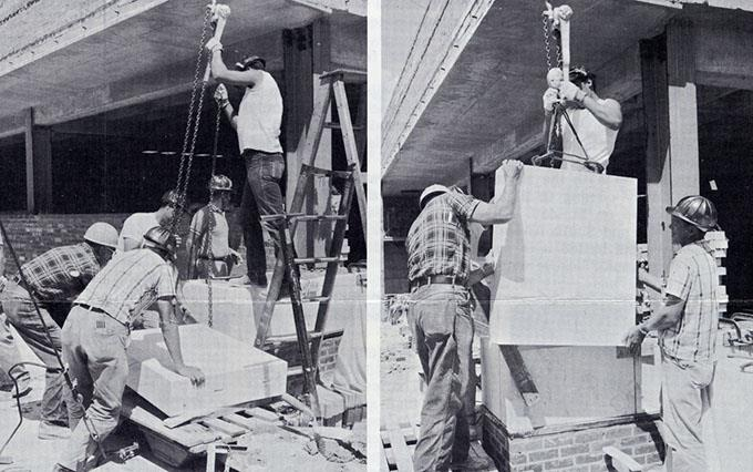 Corner stones which weigh 1,000 pounds are nearly double the weight of the 3-inch stones. Here, a corner stone is placed on the penthouse on top of the 19th floor. A hand-operated hoist, hooked to pins driven into the marble, lifts it into position.