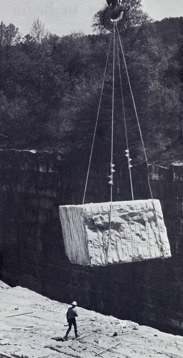 That's a 15 to 20 ton marble block that's being lifted from the quarry. It will be moved to a shop where it's first rough-sawed, then sliced with high-speed diamond saws to pieces as specified in orders. Most of the marble facing the Mayo Building is 3 inches thick.