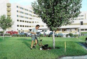 Groundskeeper Mark Pancoast knows only too well how fast grass grows in the humid Florida climate at St. Luke's Hospital.