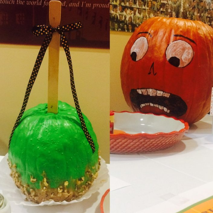 A caramel apple and a very frightened pumpkin.
